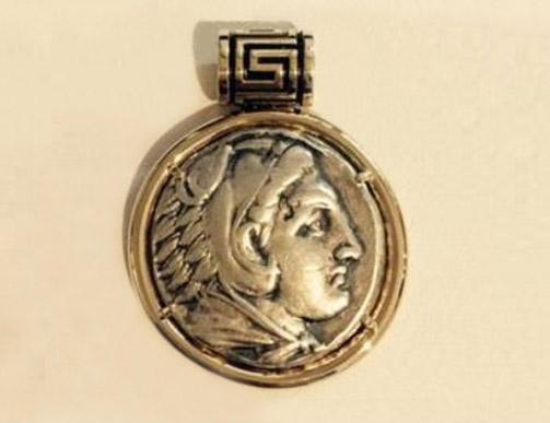 14k yellow gold bezel pendant coin.
