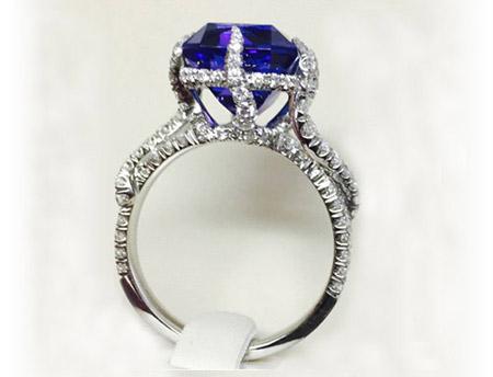 platinum ring, set with radiant cut tanzanite and 122 full cut diamonds