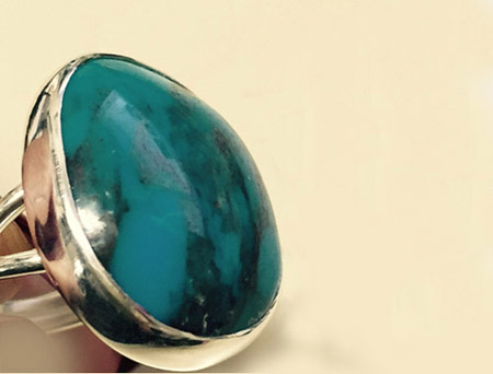 sterling silver ladies ring with turquoise cabochon